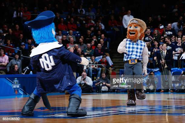 The Mount St Mary's Mountaineers mascot and the New Orleans Privateers mascot perform during the First Four game in the 2017 NCAA Men's Basketball...