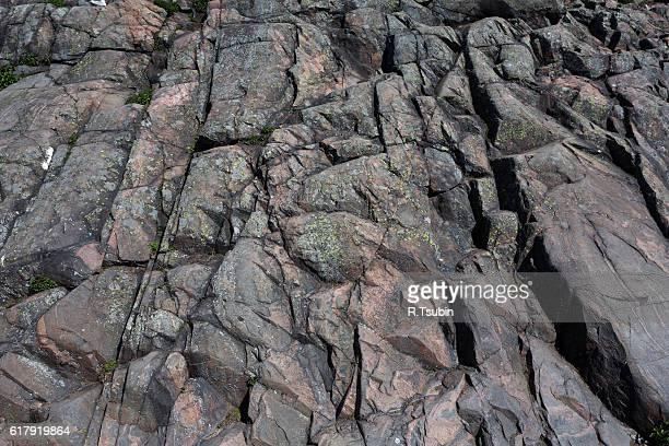 the mountain granite rock - stone wall stock-fotos und bilder