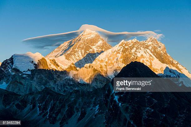 The mountain Mt Everest with a white cloud on top seen from Gokyo Ri at sunset