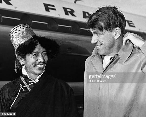 The mountaineer Sir Edmund Hillary the first man to conquer Everest with Khumbo Chumbi a Sherpa village elder after arriving in London bringing what...