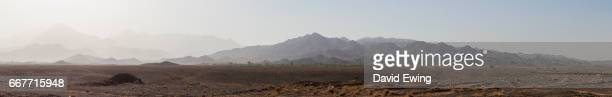 the mountainous landscape of the barren desert in iran - david ewing stock pictures, royalty-free photos & images