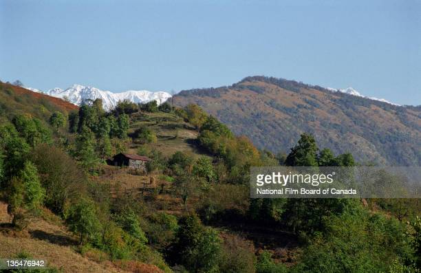The mountainous region with snowcapped mountains visible in the distance of the Gali district Abkhazia November 2002 Photo taken during the National...
