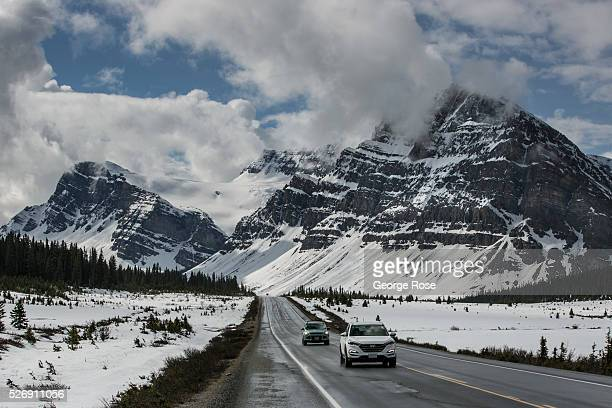 The mountains along the Icefields Parkway between Lake Louise and Jasper are coated in a light dusting of snow on April 25 2016 near Jasper Alberta...