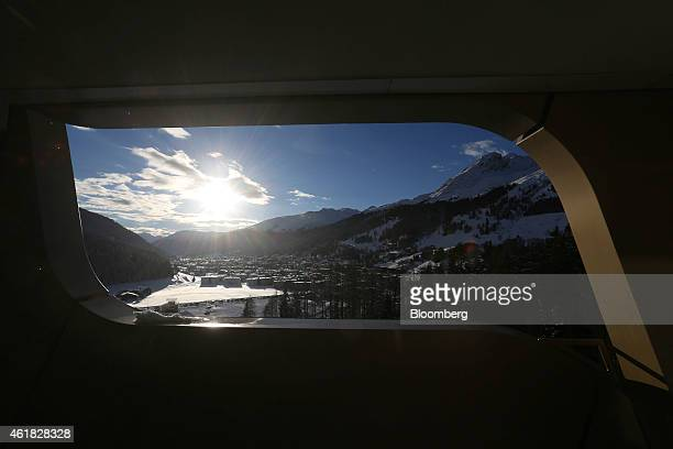 The mountains and the town of Davos are seen from the balcony of a guest bedroom at the InterContinental Hotel Davos operated by InterContinental...