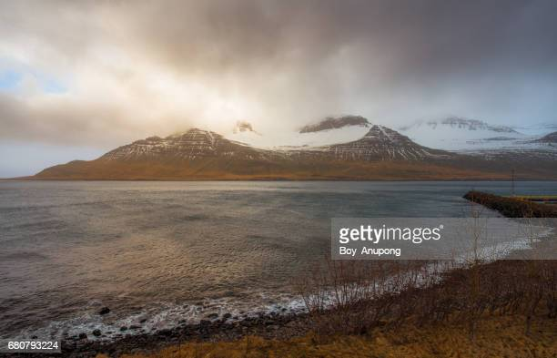 the mountains fjord in stodvarfjordur town of east iceland. - austurland stock pictures, royalty-free photos & images