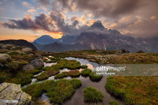 the mountains pale di san martino and cimon della pala at sunrise. unesco world heritage site. - wilderness area stock pictures, royalty-free photos & images
