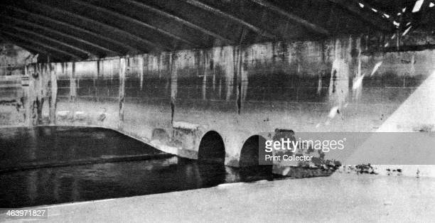 The mouth of the Holebourne where it finds the Thames as the Fleet Ditch London 19261927 The picture shown is under the Blackfriars Railway bridge...