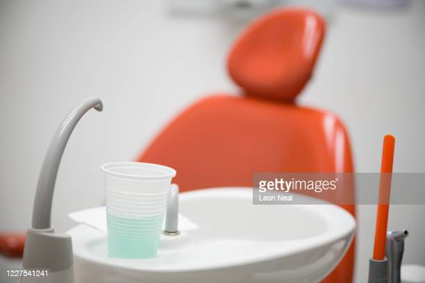 The mouthwash bowl is seen by a dental surgery chair at East Village dental practice on May 28, 2020 in London, England. With dental staff facing a...