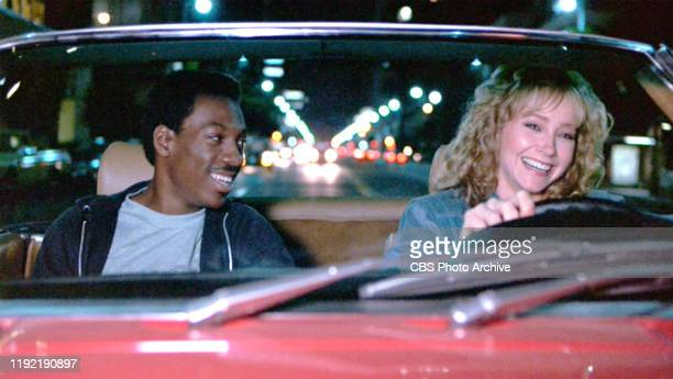 The movie Beverly Hills Cop directed by Martin Brest Seen here from left Eddie Murphy as Det Axel Foley and Lisa Eilbacher as Jenny Summers in a 1980...
