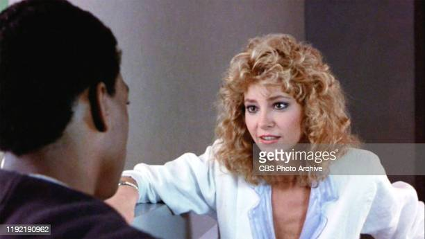 The movie Beverly Hills Cop directed by Martin Brest Seen here from left Eddie Murphy as Det Axel Foley facing Lisa Eilbacher as Jenny Summers in the...