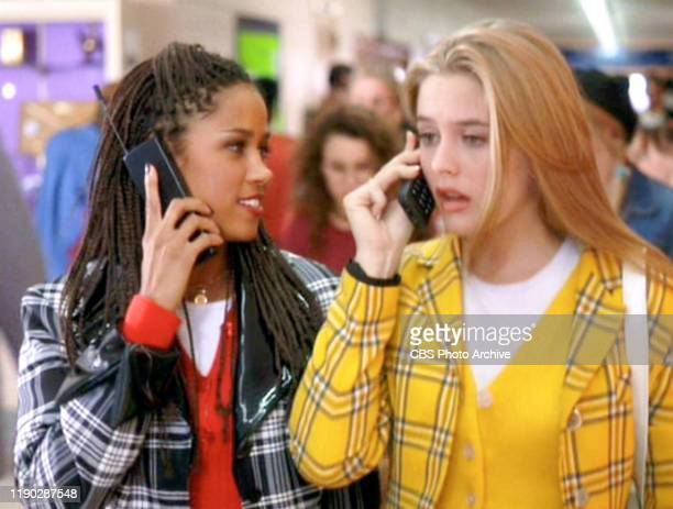 """The movie """"Clueless"""", written and directed by Amy Heckerling. Seen here from left, Stacey Dash , and Alicia Silverstone . Theyre using cell phones...."""