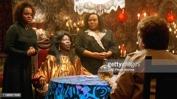 The movie Ghost directed by Jerry Zucker and written by Bruce Joel Rubin Seen here facing forward from left Gail Boggs as Clara Brown Whoopi Goldberg...