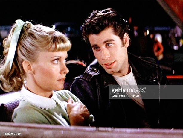 "The movie ""Grease"", directed by Randal Kleiser. Seen here at the drive-in Olivia Newton-John as Sandy and John Travolta as Danny Zuko. Initial..."