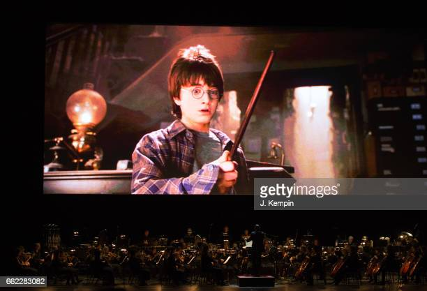 The movie Harry Potter And The Sorcerer's Stone is seen onscreen during the Harry Potter And The Sorcerer's Stone Concert at Radio City Music Hall on...