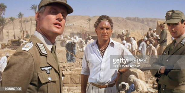 The movie Indiana Jones and the Raiders of the Lost Ark directed by Steven Spielberg Seen here from left Wolf Kahler as Dietrich Paul Freeman as...