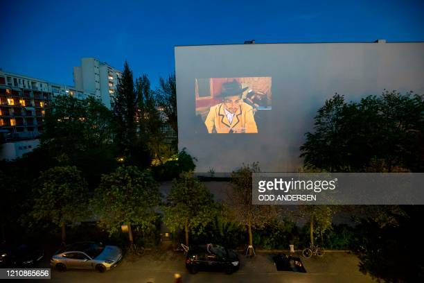 "The movie ""Loving Vincent"" is projected on the wall of a building in Berlin's Kreuzberg district on April 23, 2020 during the ongoing Covid-19 novel..."