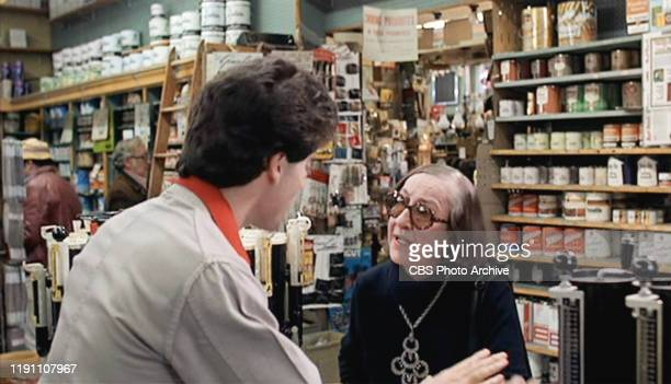 The movie Saturday Night Fever directed by John Badham Seen here from left John Travolta as Tony Manero facing Helen Travolta as Lady in Paint Store...