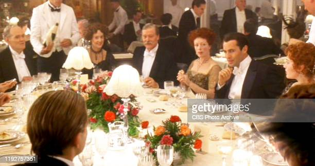"""The movie """"Titanic"""", written and directed by James Cameron. Seen here from left, seated at far end of table, Michael Ensign as Benjamin Guggenheim,..."""