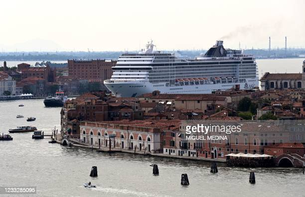 The MSC Orchestra cruise ship sails across the basin as it leaves Venice on June 05, 2021. - The cruise ship, which arrived in Venice on June 03,...