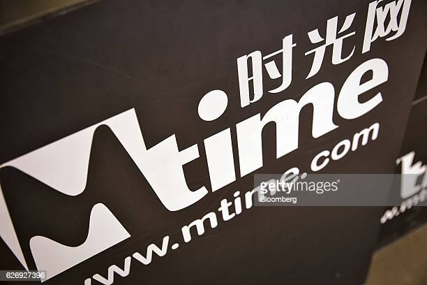 The Mtimecom Inc logo is displayed at one of the company's retail kiosks in a shopping mall in Beijing China on Thursday Nov 24 2016 Mtime the movie...