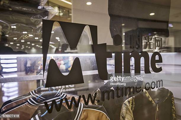 The Mtimecom Inc logo is displayed on a window at one of the company's retail kiosks in a shopping mall in Beijing China on Thursday Nov 24 2016...