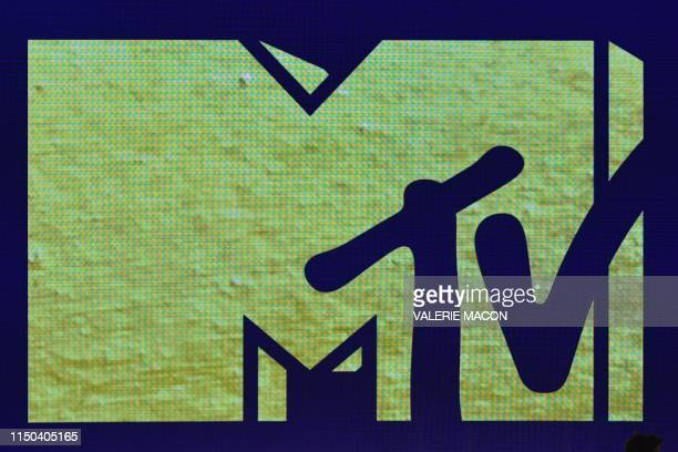 The MTV logo is shown on a screen during the 2019 MTV Movie TV Awards at the Barker Hangar in Santa Monica on June 15 2019 The 2019 MTV Movie TV...