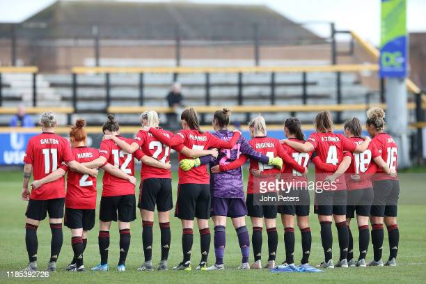 The MU Women team take part in a minute's silence to mark Remembrance Sunday ahead of the FA Women's Continental League Cup match between Everton...