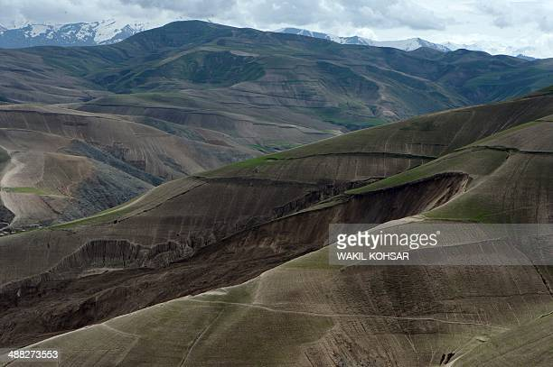 The mud and rocks of the landslide are pictured in this aerial view of Aab Bareek village at Argo district in Badakhshan province on May 5, 2014....