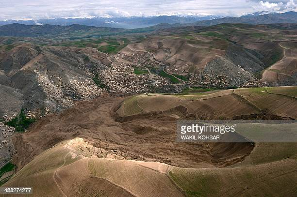 The mud and rocks of the landslide are pictured in this aerial view of Aab Bareek village at Argo district in Badakhshan province on May 5 2014...