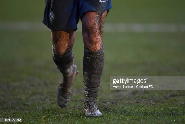 The muddy legs and socks of Erin Cuthbert of Chelsea are seen during the Barclays FA Women's Super League match between Liverpool and Chelsea at...