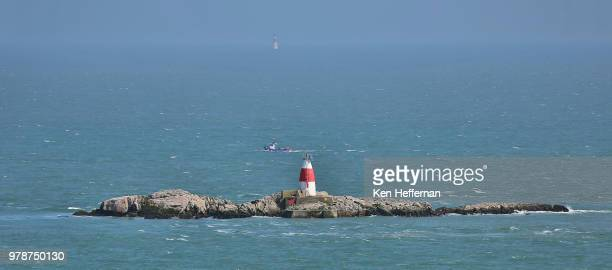the muglins lighthouse beside dalkey island - dalkey stock pictures, royalty-free photos & images