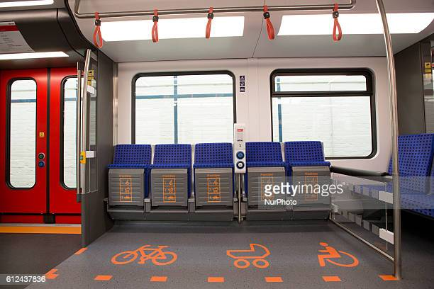 The multifunctional area with seats reserved with different grade of priority to disabled people pushchairs and bikes is pictured inside a model in...