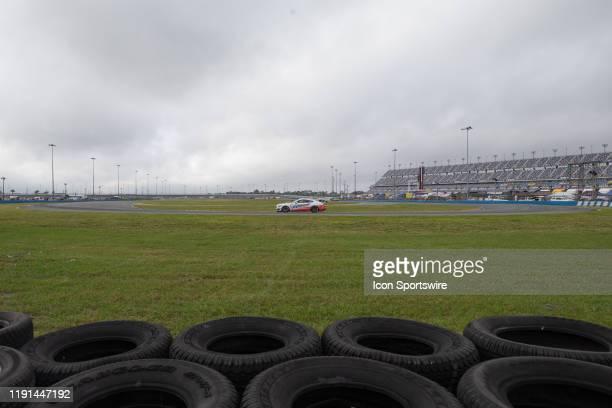 The Multimatic Motorsports Inc Ford Mustang GT4 of Hailie Deegan and Chase Briscoe races through turn during a practice session on January 3 2020 at...
