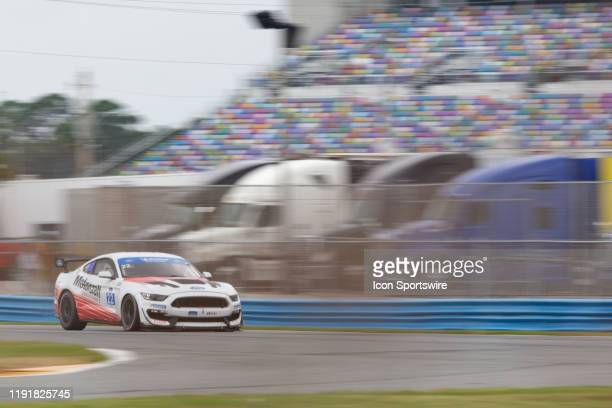 The Multimatic Motorsports Inc Ford Mustang GT4 of Hailie Deegan and Chase Briscoe races through a turn during a practice session on January 3 2020...