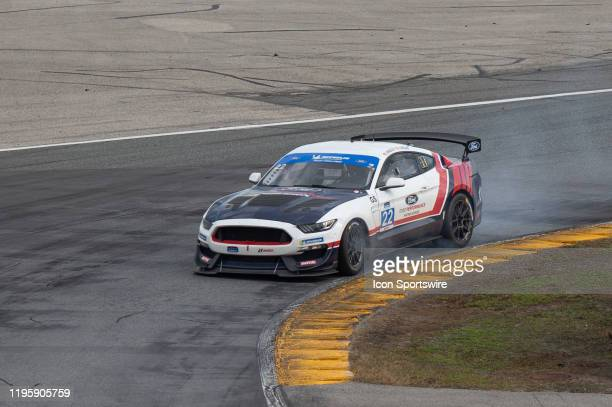 The Multimatic Motorsports Inc Ford Mustang GT4 of Hailie Deegan and Chase Briscoe smokes into a turn during the BMW Endurance Challenge at Daytona...