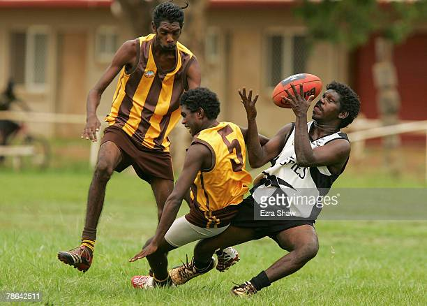 The Muluwurri Magpies from Melville Island play against the Tapalinga Super Stars in a game of Australian Rules football at their local oval on...