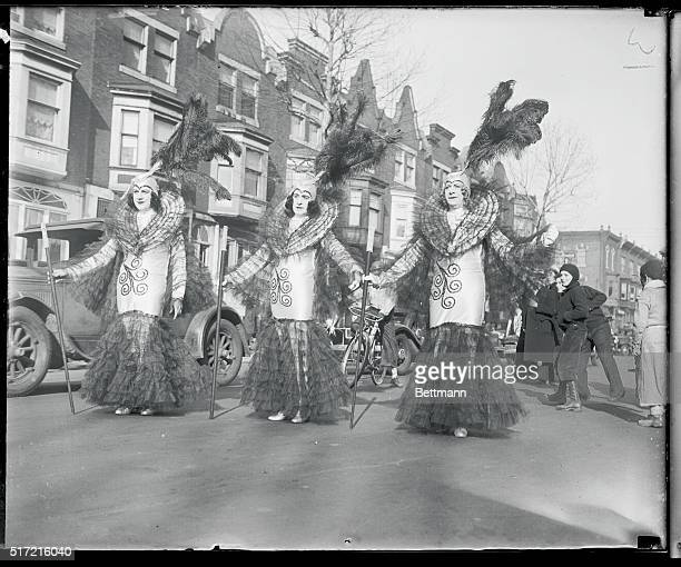The Mummers Club national organization renowned for its spectacular parades staged a colorful procession in Philadelphia Above is a trio of Parisian...