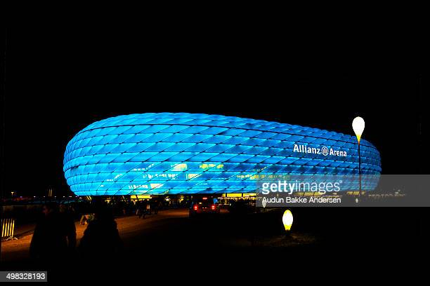 The Munich football stadium is colored blue for the occation as 1860 Munchen is playing a home game. The Allianz Arena is a football stadium in...