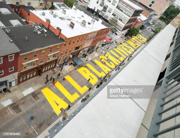 The mural that volunteers have painted is on display during All Black Lives Matter Community Painting Day on June 27 2020 in Newark New Jersey