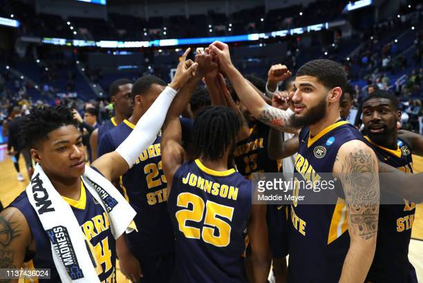 The Murray State Racers celebrate defeating the Marquette Golden Eagles 8364 after their first round game of the 2019 NCAA Men's Basketball...