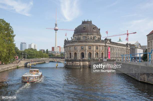 The Museum Island in the center of Berlin The photo shows the Bode Museum the river Spree with excursion steamers and the television tower