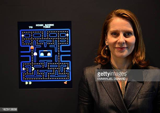The Museum of Modern Art Senior Curator of Architecture and Design Paola Antonelli poses next to the video game PacMan during a preview of the MoMa's...