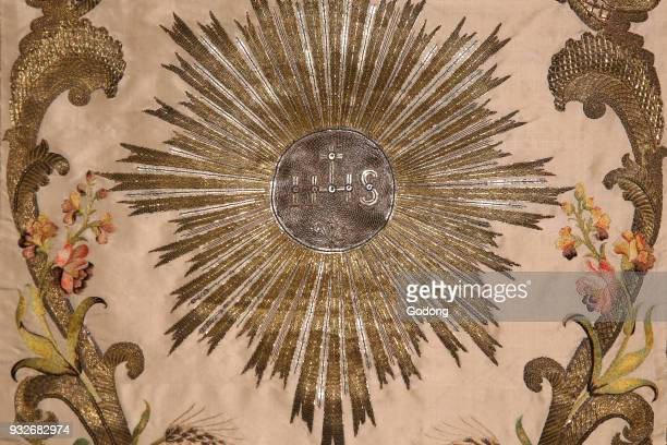 The museum of the Visitation Liturgical cloth Chasuble embroidered by the Visitandines IHS christogram Moulins France