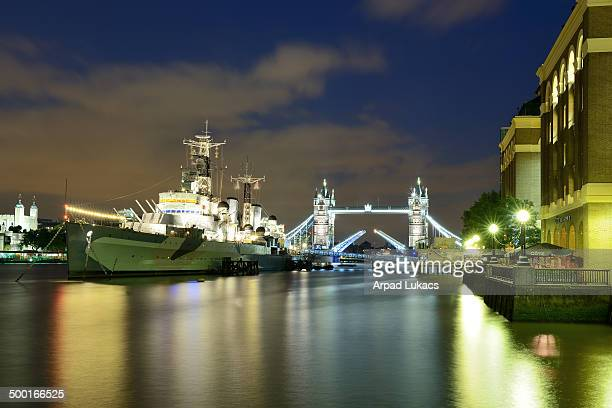 The museum ship HMS Belfast captured on the River Thames with Tower Bridge in the background.