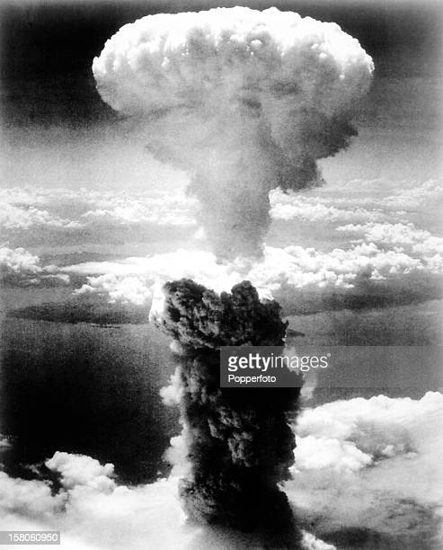 The mushroom cloud formed by the atomic bomb dropped on the port of Nagasaki, Japan at the end of World War Two on 8th August 1945. This image is...