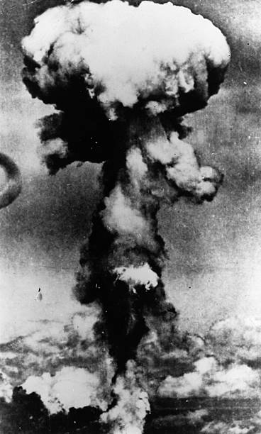 The mushroom-shaped cloud following the dropping of...