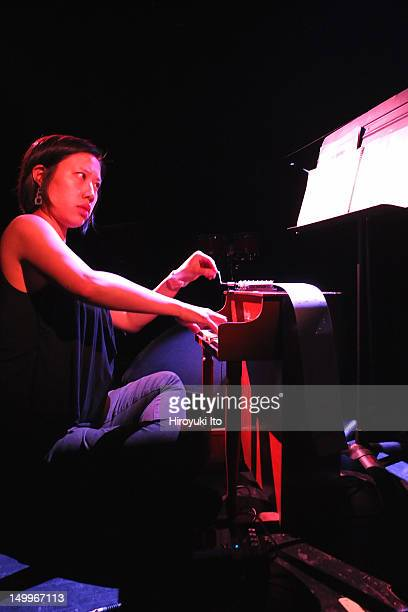 The music of John Cage at Le Poisson Rouge on Sunday night July 8 2012This imagePhyllis Chen playing toy piano and music box in Music for Carillon
