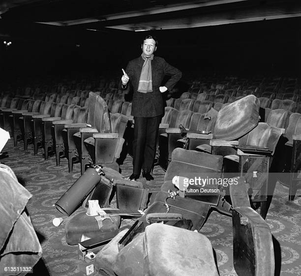 The music producer and manager of The Beatles Brian Epstein stands amidst broken seating at the Saville Theatre in London 1960s