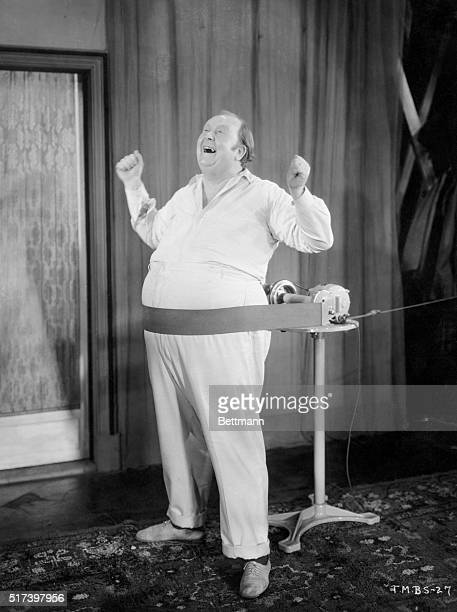 The musical beauty shop A portly gentleman sings as his belly is mechanically massaged Undated B/W photograph