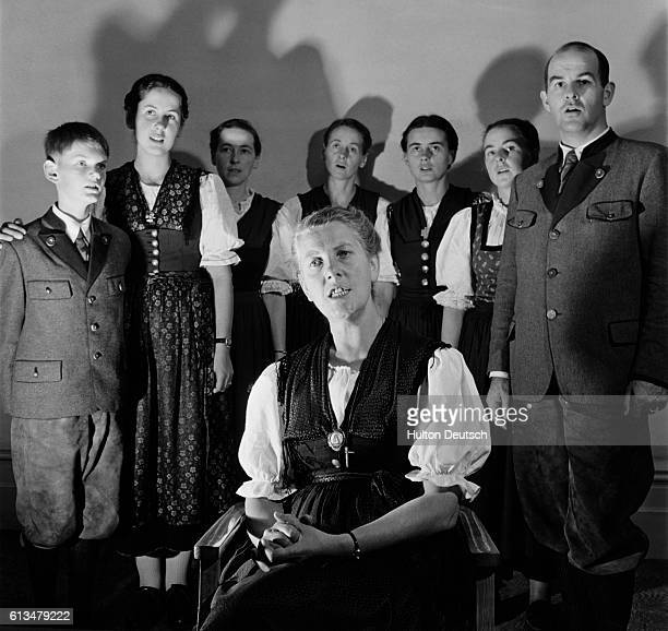 The musical Von Trapp family sing together with Baroness Maria Augusta Von Trapp seated and the children Johannes Eleonore Hedwig Martina Maria...